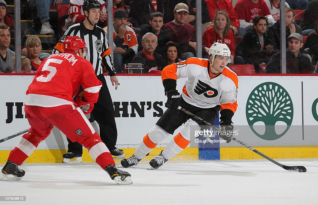 James Van Riemsdyk #21 of the Philadelphia Flyers tries to skate around <a gi-track='captionPersonalityLinkClicked' href=/galleries/search?phrase=Nicklas+Lidstrom&family=editorial&specificpeople=201470 ng-click='$event.stopPropagation()'>Nicklas Lidstrom</a> #5 of the Detroit Red Wings in a game on January 2, 2011 at the Joe Louis Arena in Detroit, Michigan. The Flyers defeated the Wings 3-2.