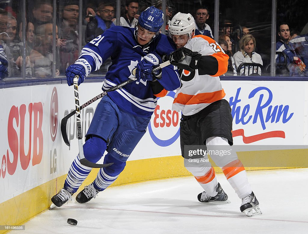 James van Riemsdyk #21 of the Toronto Maple Leafs battles for the puck with <a gi-track='captionPersonalityLinkClicked' href=/galleries/search?phrase=Bruno+Gervais&family=editorial&specificpeople=215079 ng-click='$event.stopPropagation()'>Bruno Gervais</a> #27 of the Philadelphia Flyers during NHL game action February 11, 2013 at the Air Canada Centre in Toronto, Ontario, Canada.