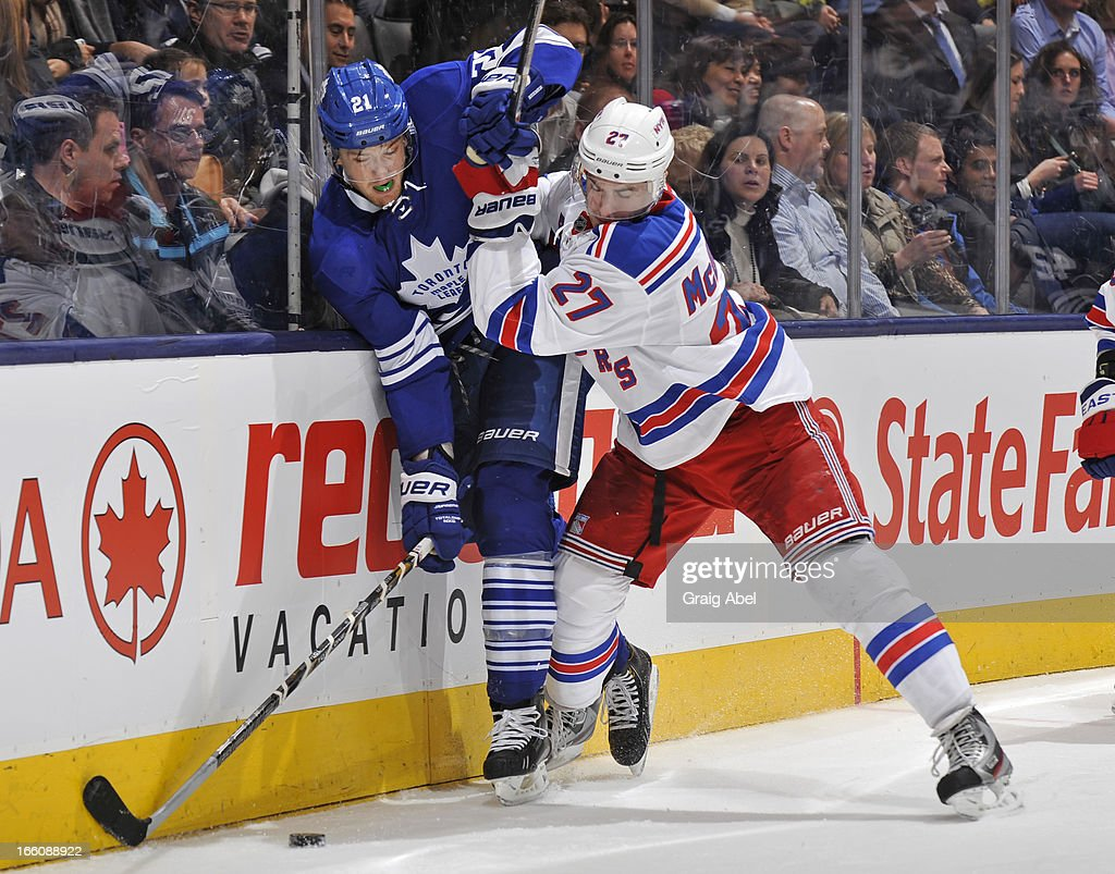 James van Riemsdyk #21 of the Toronto Maple Leafs battles for the puck with <a gi-track='captionPersonalityLinkClicked' href=/galleries/search?phrase=Ryan+McDonagh&family=editorial&specificpeople=4324983 ng-click='$event.stopPropagation()'>Ryan McDonagh</a> #27 of the New York Rangers during NHL game action April 8, 2013 at the Air Canada Centre in Toronto, Ontario, Canada.