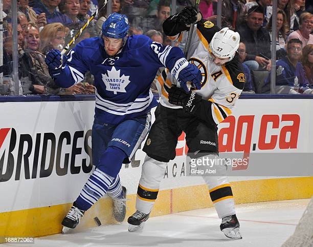 James van Riemsdyk of the Toronto Maple Leafs battles for the puck with Patrice Bergeron of the Boston Bruins in Game Six of the Eastern Conference...