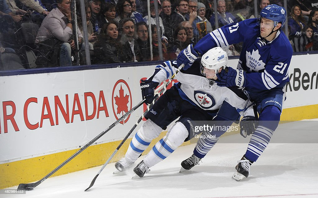 James van Riemsdyk #21 of the Toronto Maple Leafs battles for the puck with <a gi-track='captionPersonalityLinkClicked' href=/galleries/search?phrase=Jacob+Trouba&family=editorial&specificpeople=8050718 ng-click='$event.stopPropagation()'>Jacob Trouba</a> #8 of the Winnipeg Jets during NHL game action April 5, 2014 at the Air Canada Centre in Toronto, Ontario, Canada.
