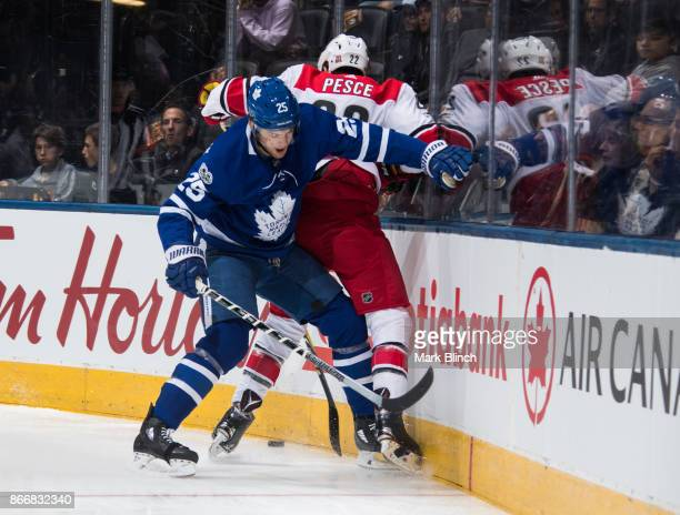 James van Riemsdyk of the Toronto Maple Leafs battles for the puck against Brett Pesce of the Carolina Hurricanes during the first period at the Air...