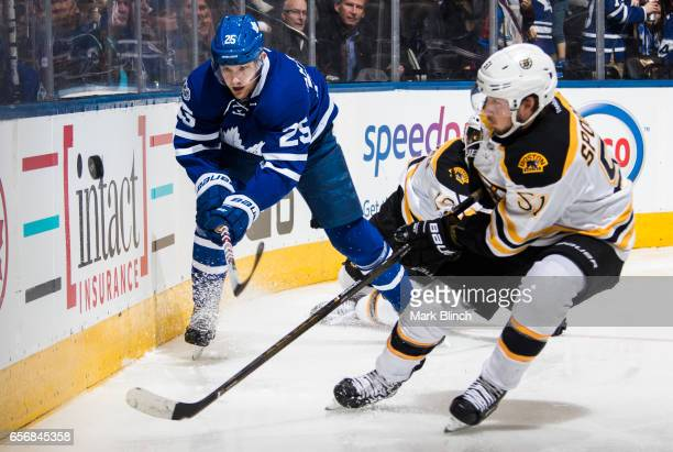 James van Riemsdyk of the Toronto Maple Leafs battles with Ryan Spooner of the Boston Bruins during the second period at the Air Canada Centre on...