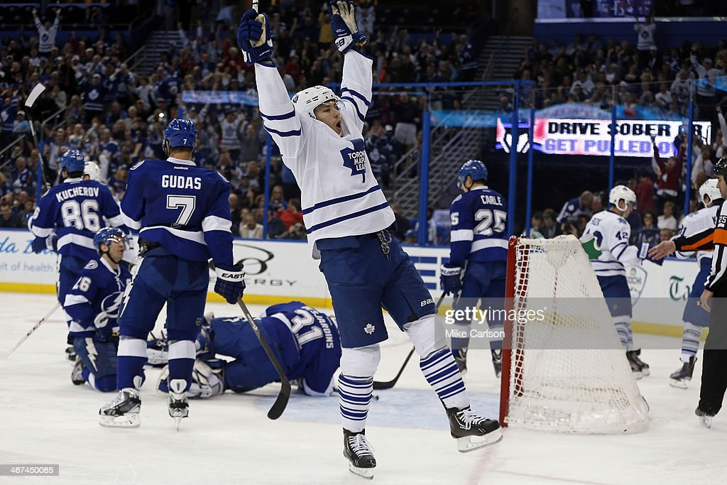 James van Riemsdyk #21 (C) of the Toronto Maple Leafs celebrates a goal against the Tampa Bay Lightning at the Tampa Bay Times Forum on February 6, 2014 in Tampa, Florida.