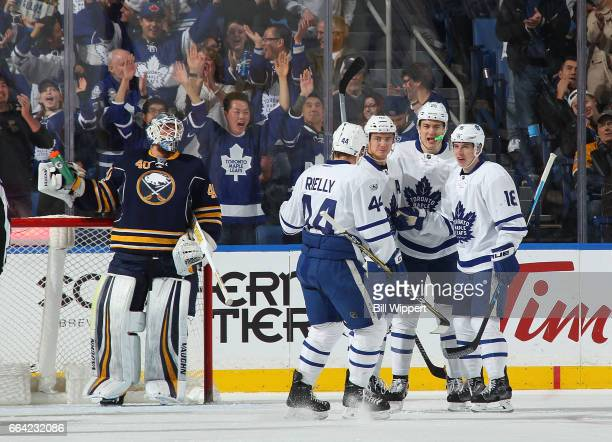 James van Riemsdyk of the Toronto Maple Leafs celebrates his first period goal against Robin Lehner of the Buffalo Sabres during an NHL game at the...