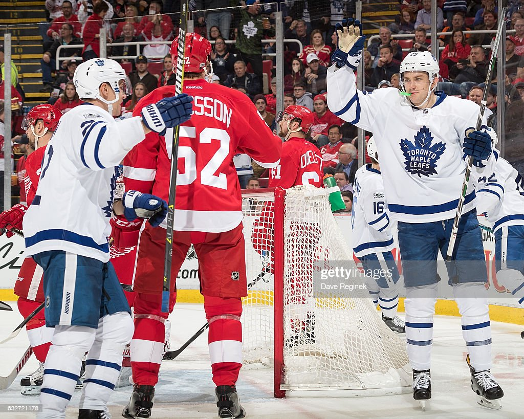James van Riemsdyk #25 of the Toronto Maple Leafs celebrates his third period goal with teammate Nikita Zaitsev #22 in front of Jonathan Ericsson #52 of the Detroit Red Wings during an NHL game at Joe Louis Arena on January 25, 2017 in Detroit, Michigan.