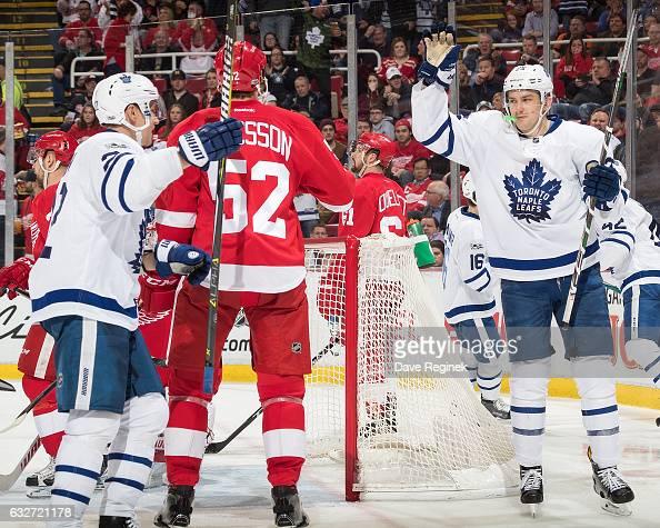 James van Riemsdyk of the Toronto Maple Leafs celebrates his third period goal with teammate Nikita Zaitsev in front of Jonathan Ericsson of the...