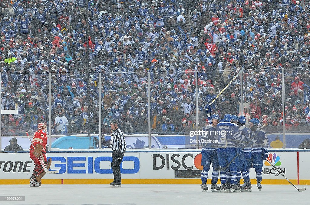 James van Riemsdyk of the Toronto Maple Leafs celebrates with teammates Carl Gunnarsson Dion Phaneuf Tyler Bozak and Phil Kessel after scoring in the...