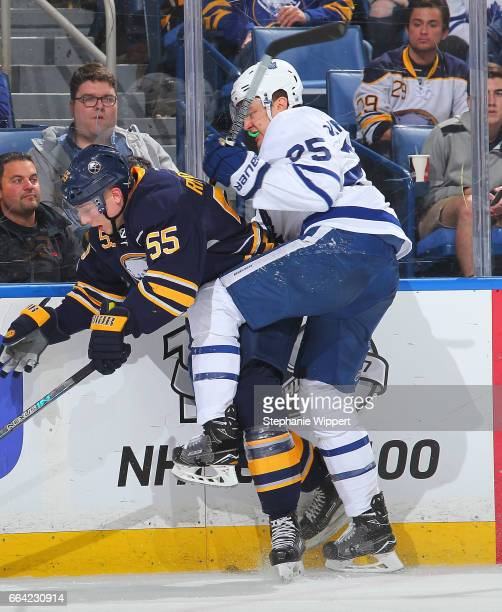 James van Riemsdyk of the Toronto Maple Leafs checks Rasmus Ristolainen of the Buffalo Sabres during an NHL game at the KeyBank Center on April 3...