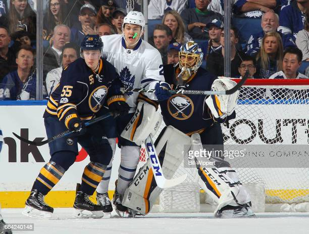 James van Riemsdyk of the Toronto Maple Leafs gets between Rasmus Ristolainen and Anders Nilsson of the Buffalo Sabres during an NHL game at the...
