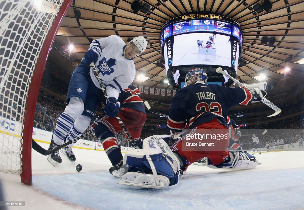 James van Riemsdyk #21 of the Toronto Maple Leafs gets tripped up in front of <a gi-track='captionPersonalityLinkClicked' href=/galleries/search?phrase=Cam+Talbot&family=editorial&specificpeople=7185126 ng-click='$event.stopPropagation()'>Cam Talbot</a> #33 of the New York Rangers at Madison Square Garden on December 23, 2013 in New York City. The Rangers defeated the Maple Leafs 2-1 in the shootout.