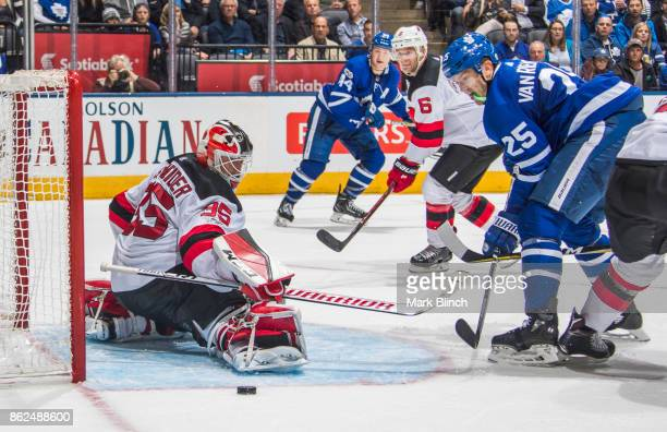 James van Riemsdyk of the Toronto Maple Leafs goes to the net against Cory Schneider of the New Jersey Devils during the third period at the Air...