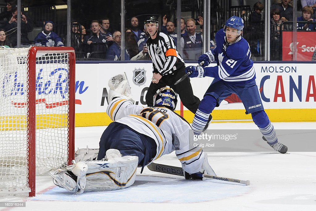 James van Riemsdyk #21 of the Toronto Maple Leafs is stopped in close by Ryan Miller #30 of the Buffalo Sabres during NHL game action February 21, 2013 at the Air Canada Centre in Toronto, Ontario, Canada.