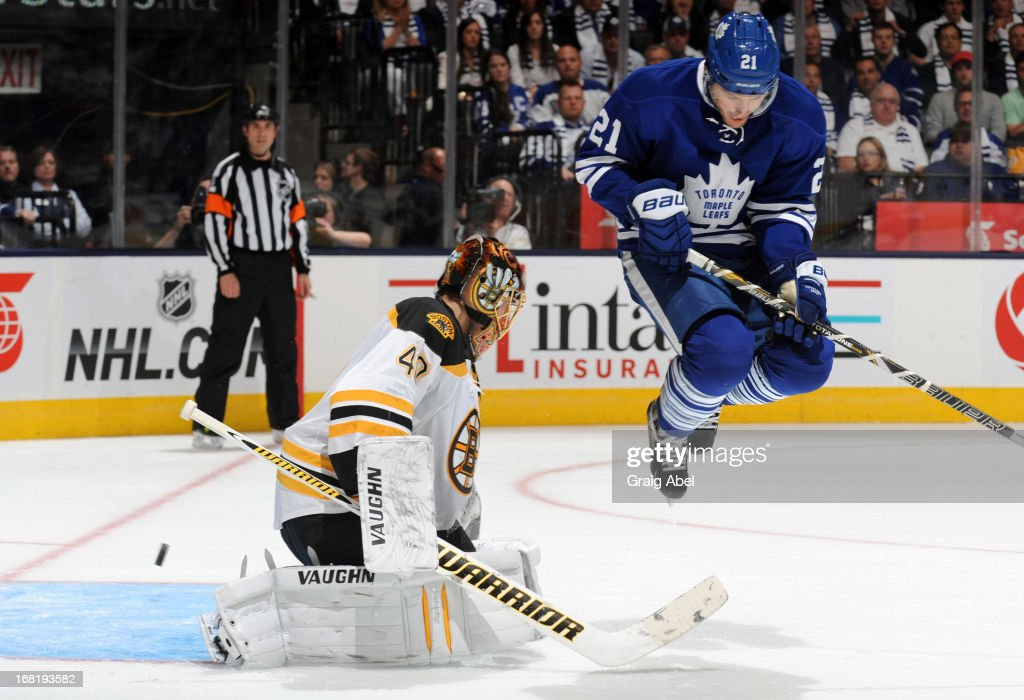 James van Riemsdyk #21 of the Toronto Maple Leafs jumps in front of goalie Tuukka Rask #40 of the Boston Bruins in Game Three of the Eastern Conference Quarterfinals during the 2013 NHL Stanley Cup Playoffs May 6, 2013 at the Air Canada Centre in Toronto, Ontario, Canada.