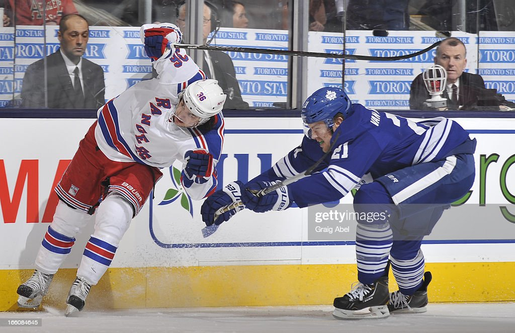 James van Riemsdyk #21 of the Toronto Maple Leafs of checks <a gi-track='captionPersonalityLinkClicked' href=/galleries/search?phrase=Mats+Zuccarello&family=editorial&specificpeople=7219903 ng-click='$event.stopPropagation()'>Mats Zuccarello</a> #36 the New York Rangers during NHL game action April 8, 2013 at the Air Canada Centre in Toronto, Ontario, Canada.