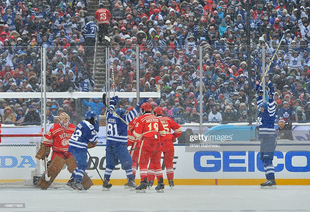 James van Riemsdyk #21 of the Toronto Maple Leafs reacts after scoring in the second period against goaltender Jimmy Howard #35 of the Detroit Red Wings during the 2014 Bridgestone NHL Winter Classic on January 1, 2014 at Michigan Stadium in Ann Arbor, Michigan.
