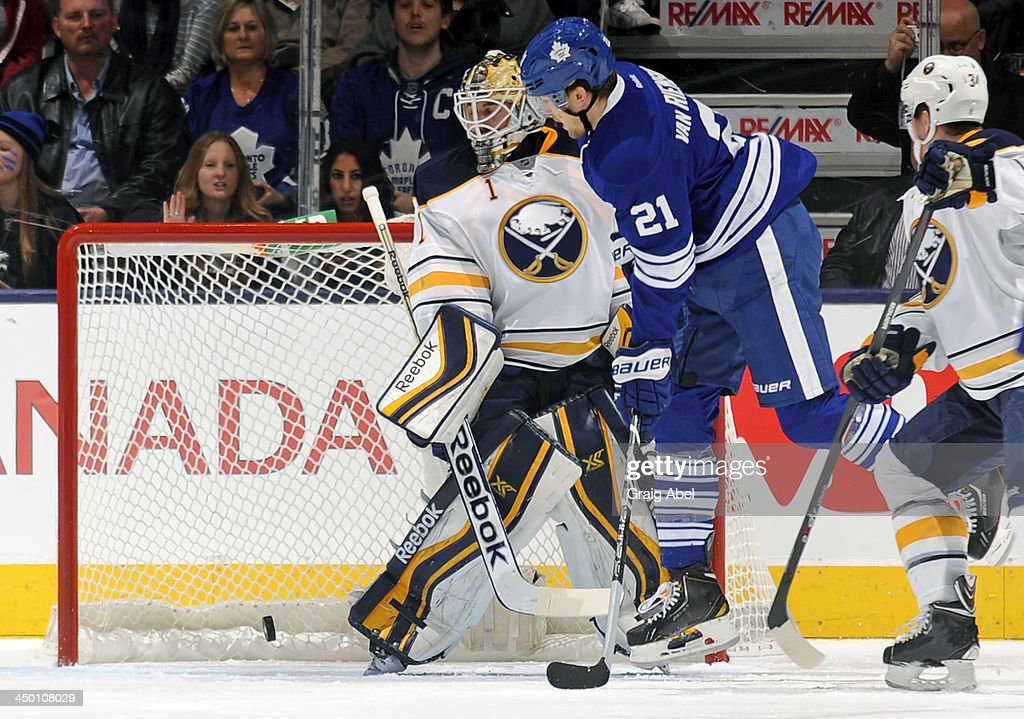 James van Riemsdyk #21 of the Toronto Maple Leafs scores a first period goal as <a gi-track='captionPersonalityLinkClicked' href=/galleries/search?phrase=Jhonas+Enroth&family=editorial&specificpeople=570456 ng-click='$event.stopPropagation()'>Jhonas Enroth</a> #1 of the Buffalo Sabres defends the goal during NHL game action November 16, 2013 at the Air Canada Centre in Toronto, Ontario, Canada.