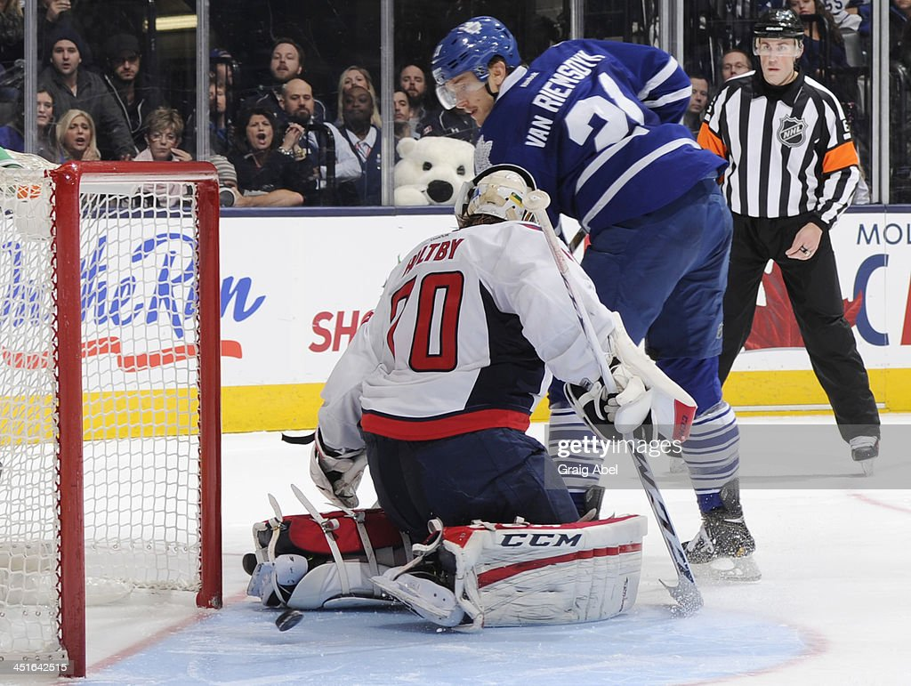 James van Riemsdyk #21 of the Toronto Maple Leafs scores a shoot-out goal on <a gi-track='captionPersonalityLinkClicked' href=/galleries/search?phrase=Braden+Holtby&family=editorial&specificpeople=5370964 ng-click='$event.stopPropagation()'>Braden Holtby</a> #70 of the Washington Capitals during NHL game action November 23, 2013 at the Air Canada Centre in Toronto, Ontario, Canada.