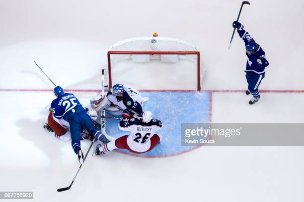 James van Riemsdyk of the Toronto Maple Leafs scores against Joonas Korpisalo of the Columbus Blue Jackets as Mitch Marner of the Toronto Maple Leafs...