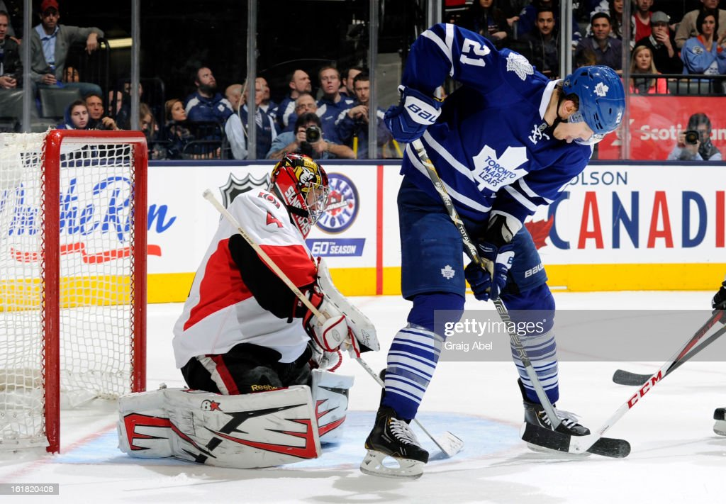 James van Riemsdyk #21 of the Toronto Maple Leafs skates in front of goalie Craig Anderson #41 of the Ottawa Senators during NHL game action February 16, 2013 at the Air Canada Centre in Toronto, Ontario, Canada.