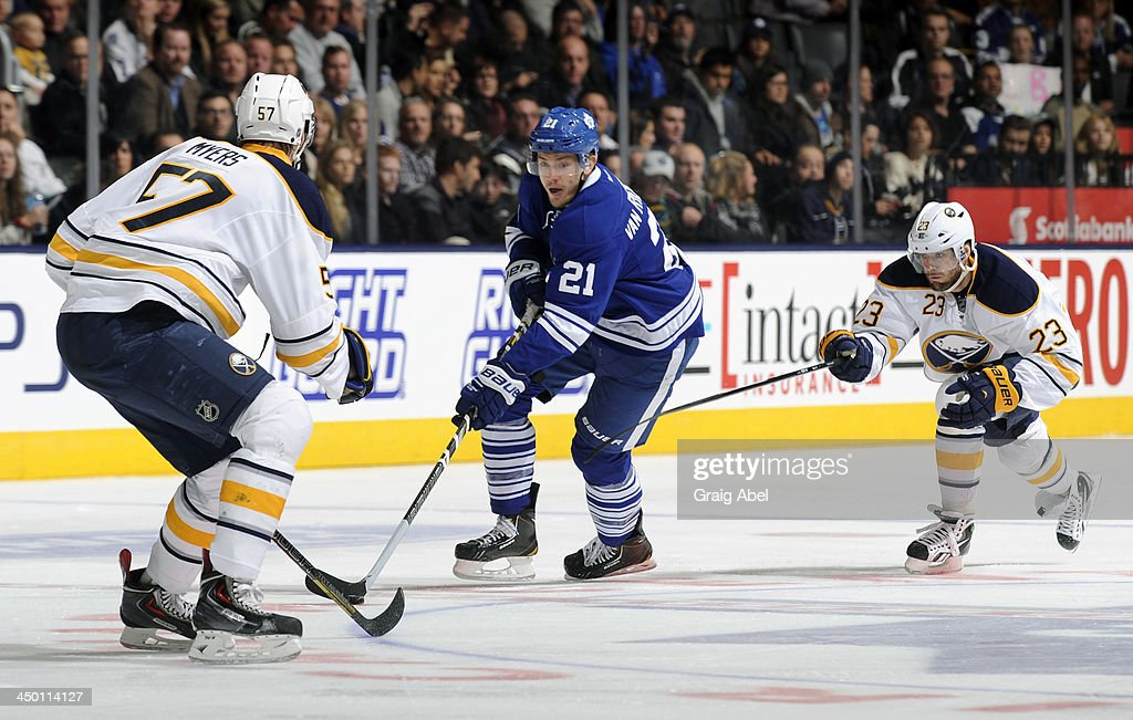 James van Riemsdyk #21 of the Toronto Maple Leafs skates with the puck as <a gi-track='captionPersonalityLinkClicked' href=/galleries/search?phrase=Tyler+Myers&family=editorial&specificpeople=4595080 ng-click='$event.stopPropagation()'>Tyler Myers</a> #57 and <a gi-track='captionPersonalityLinkClicked' href=/galleries/search?phrase=Ville+Leino&family=editorial&specificpeople=4025199 ng-click='$event.stopPropagation()'>Ville Leino</a> #23 of the Buffalo Sabres defend during NHL game action November 16, 2013 at the Air Canada Centre in Toronto, Ontario, Canada.