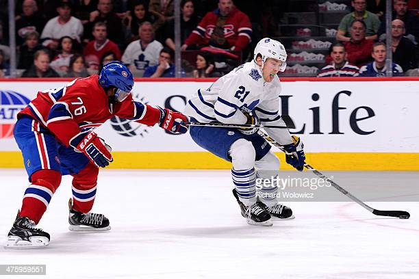 James van Riemsdyk of the Toronto Maple Leafs skates with the puck on a breakaway while being chased by PK Subban of the Montreal Canadiens during...