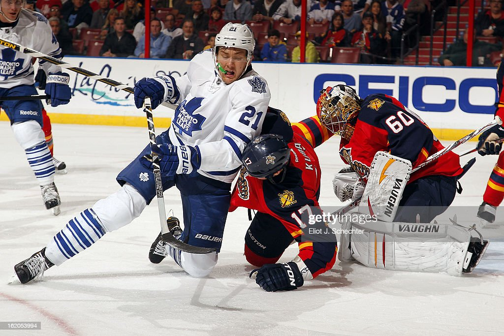 James van Riemsdyk #21 of the Toronto Maple Leafs tangles with Filip Kuba #17 of the Florida Panthers at the BB&T Center on February 18, 2013 in Sunrise, Florida.