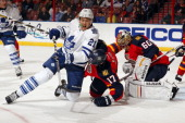 James van Riemsdyk of the Toronto Maple Leafs tangles with Filip Kuba of the Florida Panthers at the BBT Center on February 18 2013 in Sunrise Florida