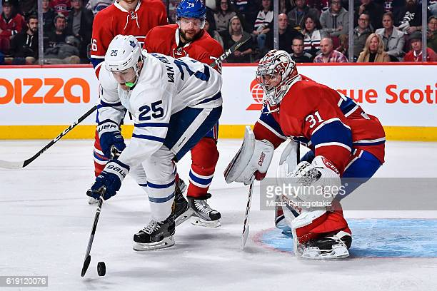 James van Riemsdyk of the Toronto Maple Leafs tries to get a shot on goaltender Carey Price of the Montreal Canadiens during the NHL game at the Bell...