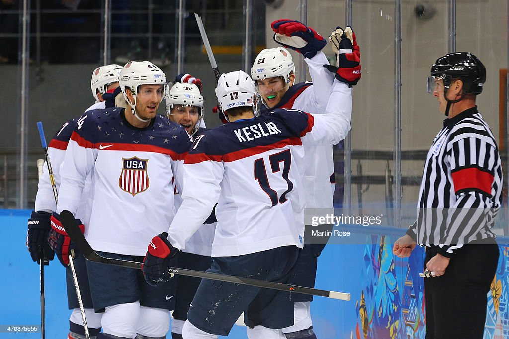 James van Riemsdyk #21 of the United States celebrates with his teammates after scoring a goal in the first period against Ondrej Pavelec #31 of the Czech Republic during the Men's Ice Hockey Quarterfinal Playoff on Day 12 of the 2014 Sochi Winter Olympics at Shayba Arena on February 19, 2014 in Sochi, Russia.