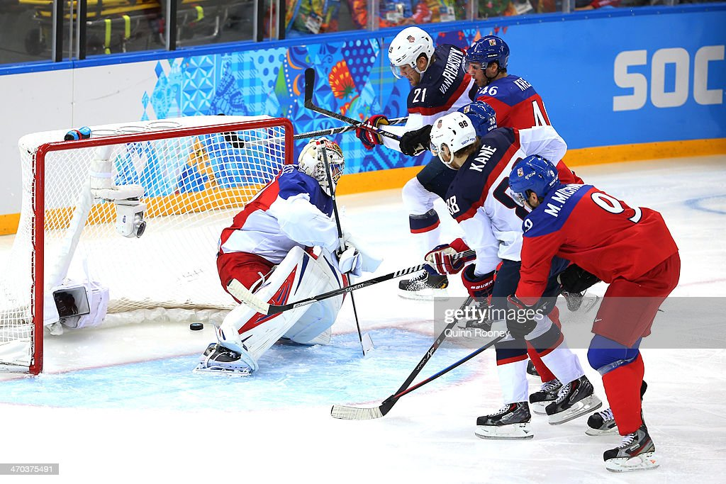 James van Riemsdyk #21 of the United States scores a goal in the first period against Ondrej Pavelec #31 of the Czech Republic during the Men's Ice Hockey Quarterfinal Playoff on Day 12 of the 2014 Sochi Winter Olympics at Shayba Arena on February 19, 2014 in Sochi, Russia.