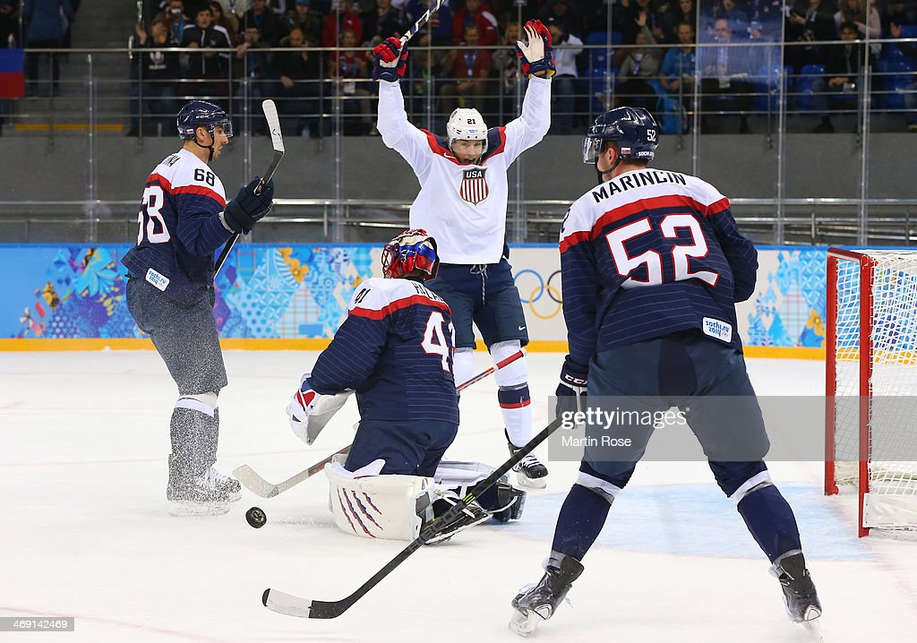 James van Riemsdyk #21 of United States celebrates after John Carlson #4 of United States scores a goal against Jaroslav Halak #41 of Slovakia in the first period during the Men's Ice Hockey Preliminary Round Group A game on day six of the Sochi 2014 Winter Olympics at Shayba Arena on February 13, 2014 in Sochi, Russia.