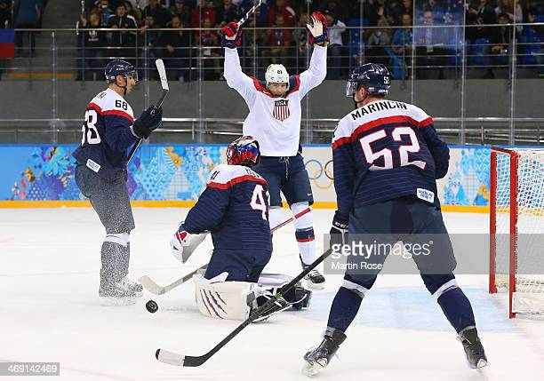 James van Riemsdyk of United States celebrates after John Carlson of United States scores a goal against Jaroslav Halak of Slovakia in the first...