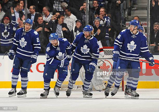 James van Riemsdyk Phil Kessel Mike Kostka and Carl Gunnarsson of the Toronto Maple Leafs celebrate a third period goal during NHL game action...