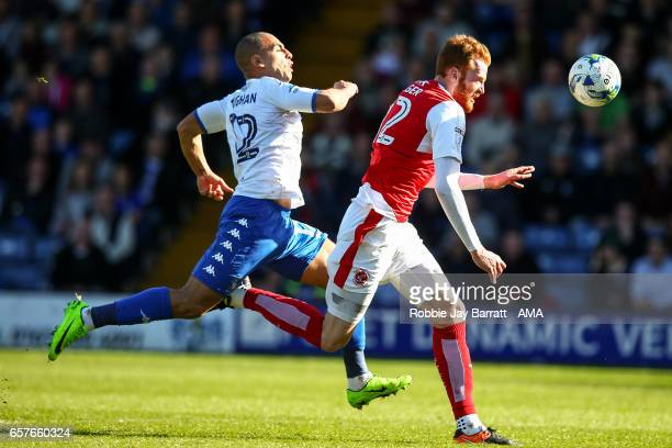 James Vaughan of Bury and Can Bolger of Fleetwood Town during the Sky Bet League One match between Bury and Fleetwood Town at Gigg Lane on March 25...