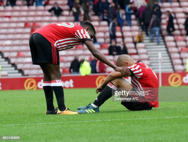 James Vaughn of Sunderland is consoled by teammate Joel Asoro during the Sky Bet Championship match between Sunderland and Cardiff City at Stadium of...