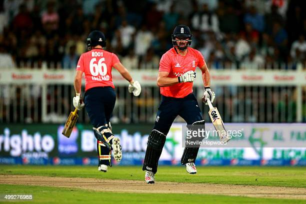 James Vince and Joe Root of England steal a single during the 3rd International T20 match between Pakistan and England at Sharjah Cricket Stadium on...