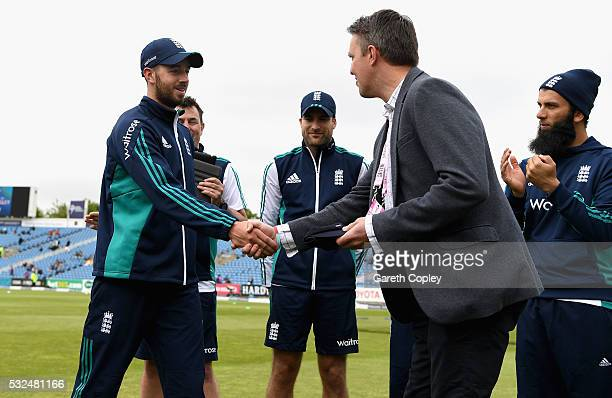 James Vince of England is presented with his test cap by former player Graeme Swann ahead of day one of the 1st Investec Test match at Headingley on...
