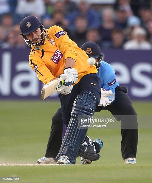 James Vince of Hampshire hits out while Ben Brown of Sussex looks on during the Natwest T20 Blast match between Sussex Sharks and Hampshire at The...