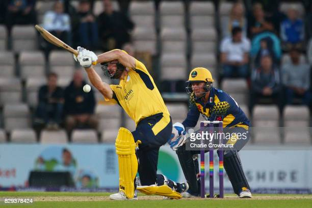 James Vince of Hampshire hits out while wicket keeper Chris Cooke of Glamorgan looks on during the NatWest T20 Blast match between Hampshire and...