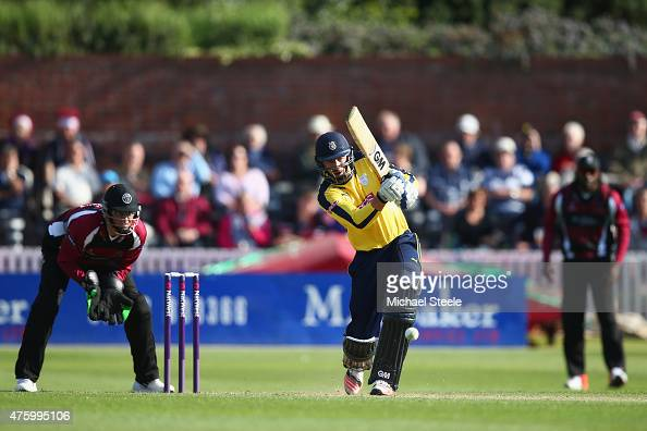 James Vince of Hampshire hits to long off as wicketkeeper Marcus Trescothick of Somerset looks on during the NatWest T20 Blast match between Somerset...