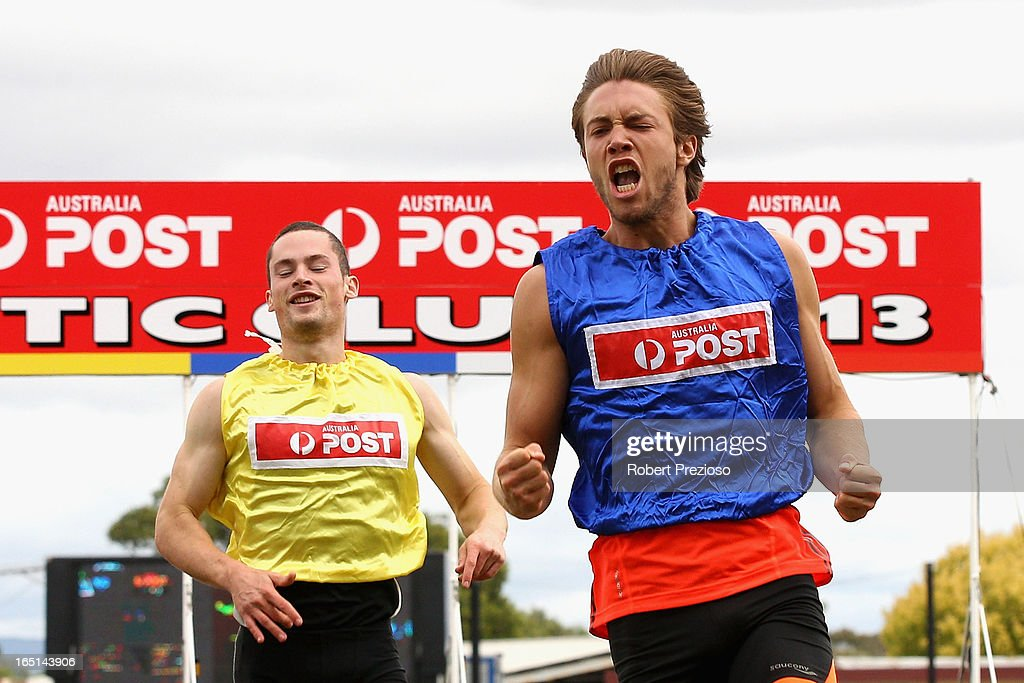 James Vine (blue) crosses the line to win in the Australia Post Stawell Gift 120m Semi Final 5 during the 2013 Stawell Gift carnival at Central Park on April 1, 2013 in Stawell, Australia.