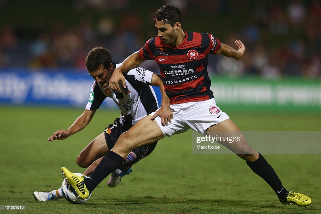 James Virgili of the Jets and Adam D'Apuzzo of the Wanderers compete for the ball during the round 20 A-League match between the Western Sydney Wanderers and the Newcastle Jets at Campbelltown Sports Stadium on February 9, 2013 in Sydney, Australia.
