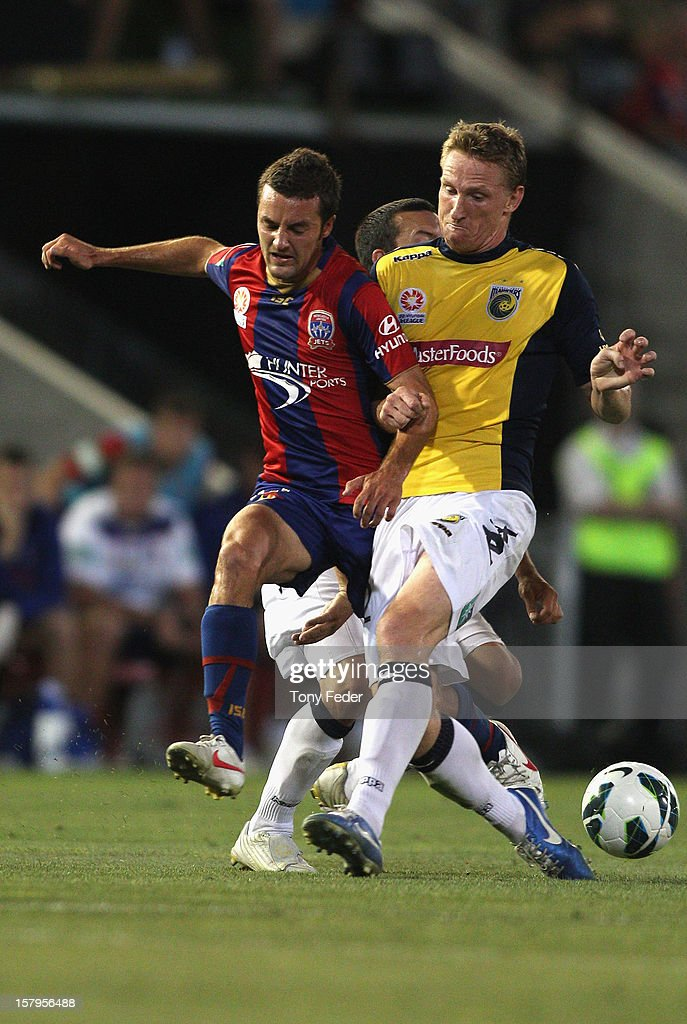 James Virgili of the Jets and Daniel McBreen of the Mariners contest the ball during the round ten A-League match between the Newcastle Jets and the Central Coast Mariners at Hunter Stadium on December 8, 2012 in Newcastle, Australia.