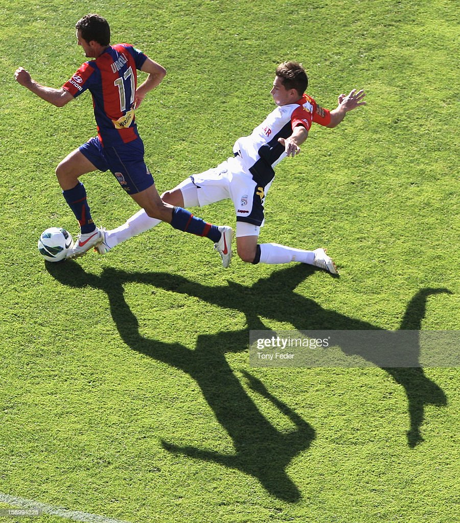 James Virgilli of the Jets controls the ball in front of his Adelaide oponent during the round 15 A-League match between the Newcastle Jets and Adelaide United at Hunter Stadium on January 5, 2013 in Newcastle, Australia.