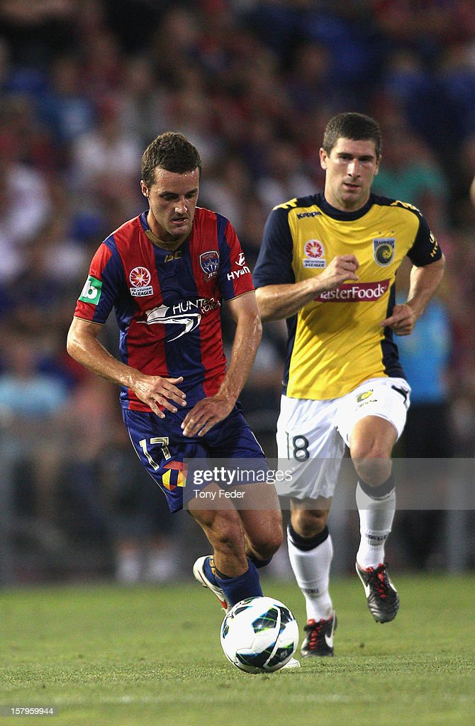 James Virgilli of the Jets controls the ball in front of Nick Montgomery of the Mariners during the round ten A-League match between the Newcastle Jets and the Central Coast Mariners at Hunter Stadium on December 8, 2012 in Newcastle, Australia.
