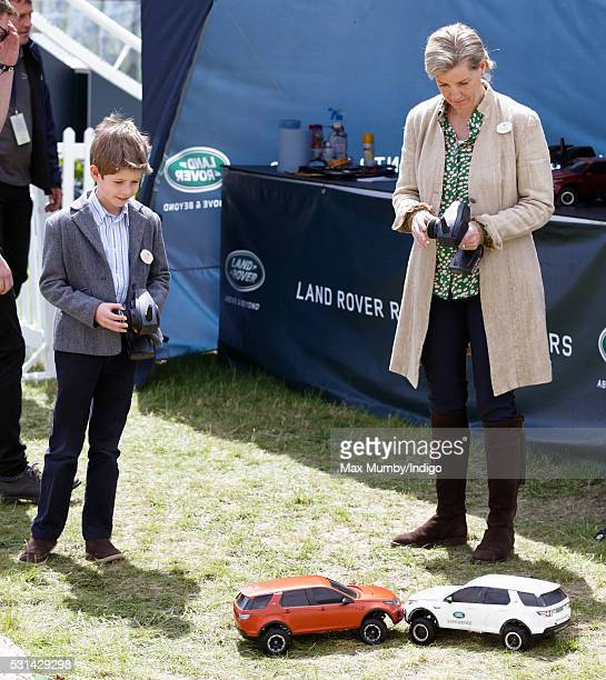 James Viscount Severn and Sophie Countess of Wessex drive radio controlled Land Rover toy cars around a model offroad course on day 4 of the Royal...