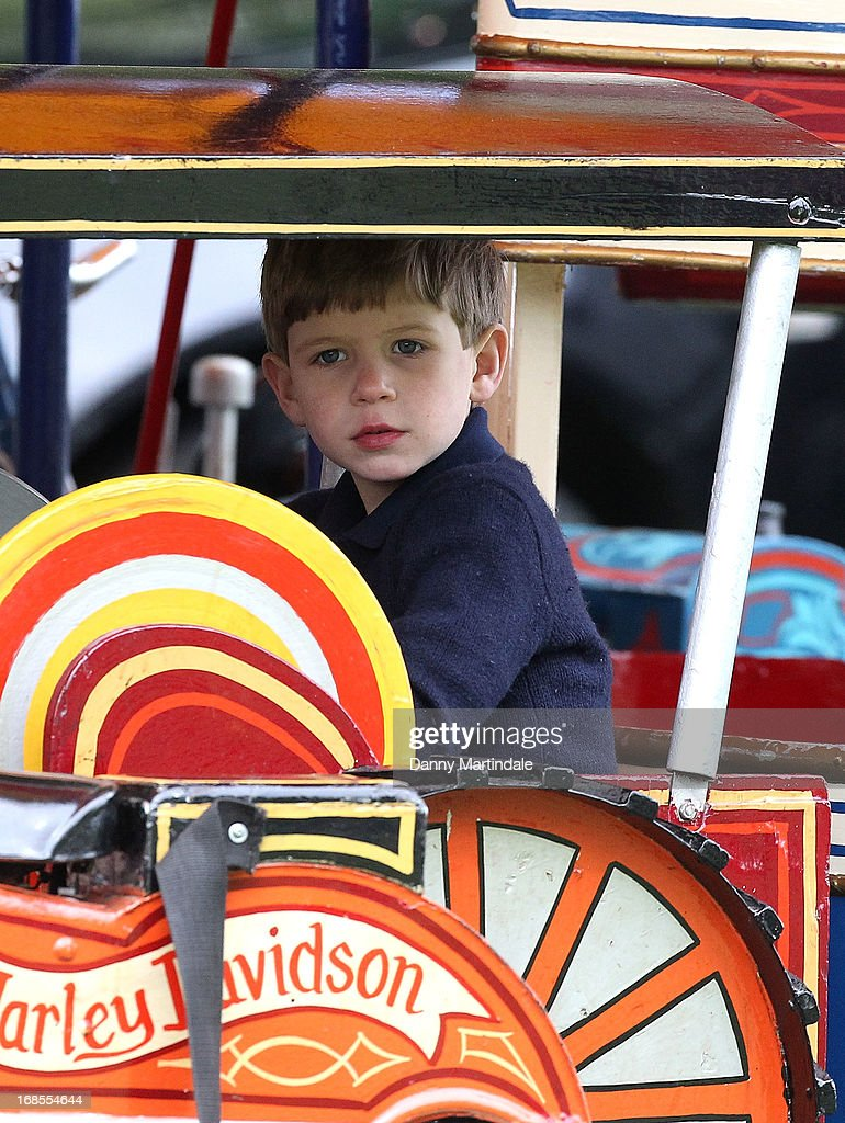 James, Viscount Severn, son of Prince Edward, Earl of Wessex and Sophie, Countess of Wessex, rides on the fun fair carousel on day 4 of the Royal Windsor Horse Show on May 11, 2013 in Windsor, England.
