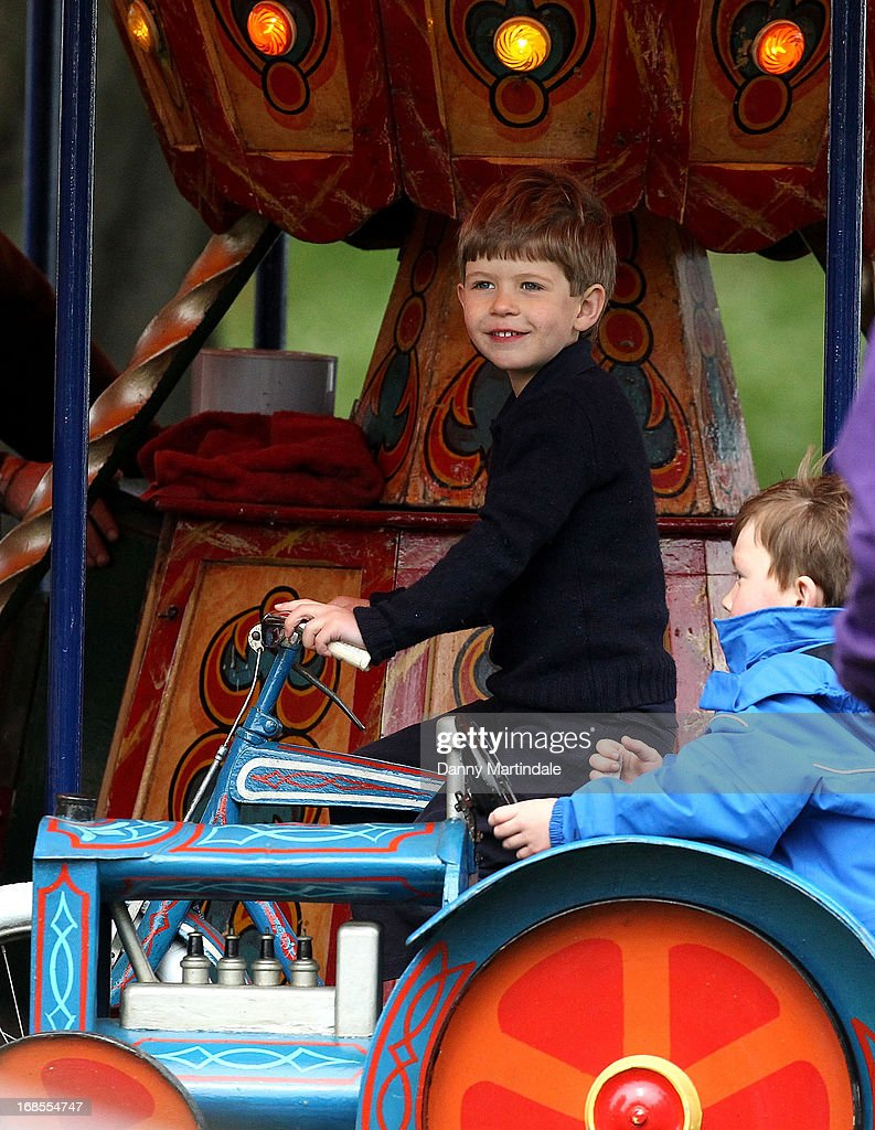 James, Viscount Severn (L), son of Prince Edward, Earl of Wessex and Sophie, Countess of Wessex, rides on the fun fair carousel on day 4 of the Royal Windsor Horse Show on May 11, 2013 in Windsor, England.