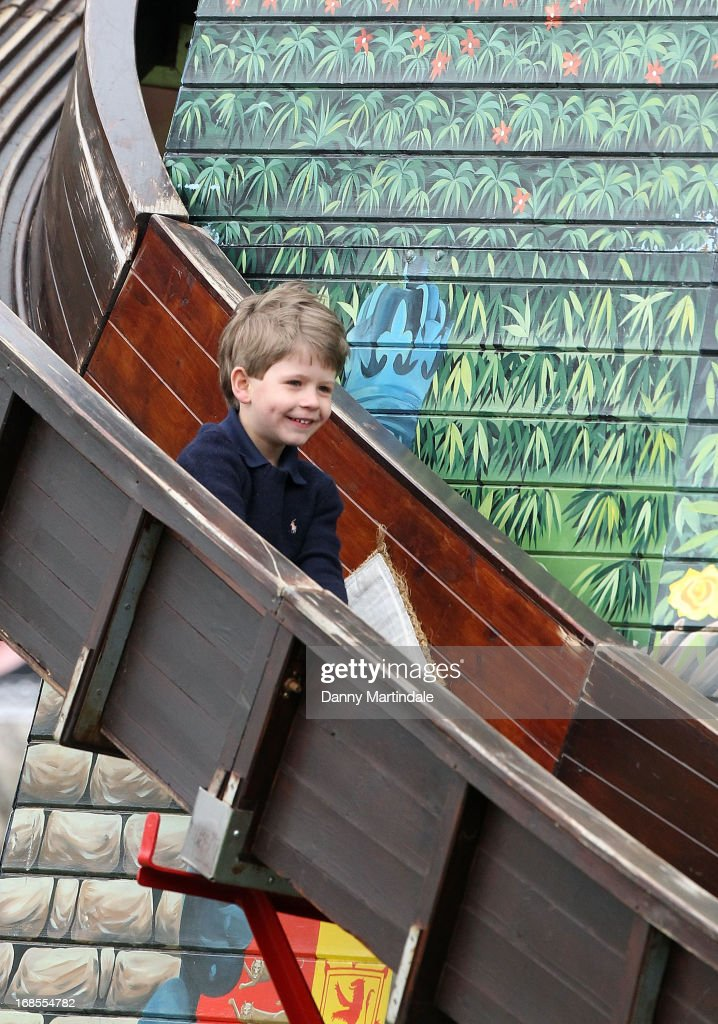 James, Viscount Severn, son of Prince Edward, Earl of Wessex and Sophie, Countess of Wessex slides down the fun fair helter skelter on day 4 of the Royal Windsor Horse Show on May 11, 2013 in Windsor, England.